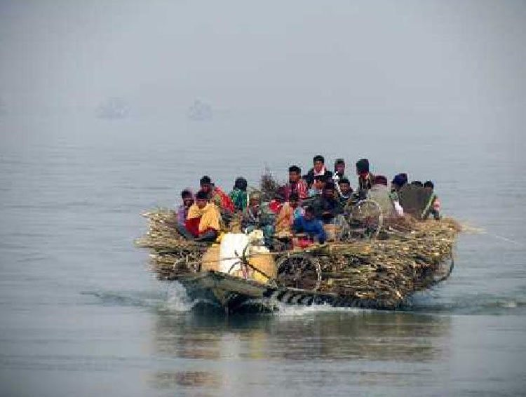 People living and travelling in the mighty Brahmaputra